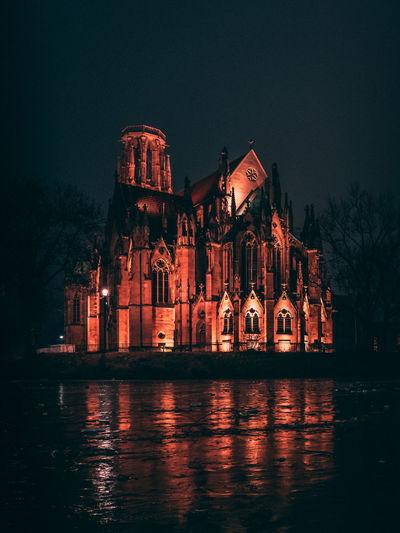 Illuminated church against clear sky at night