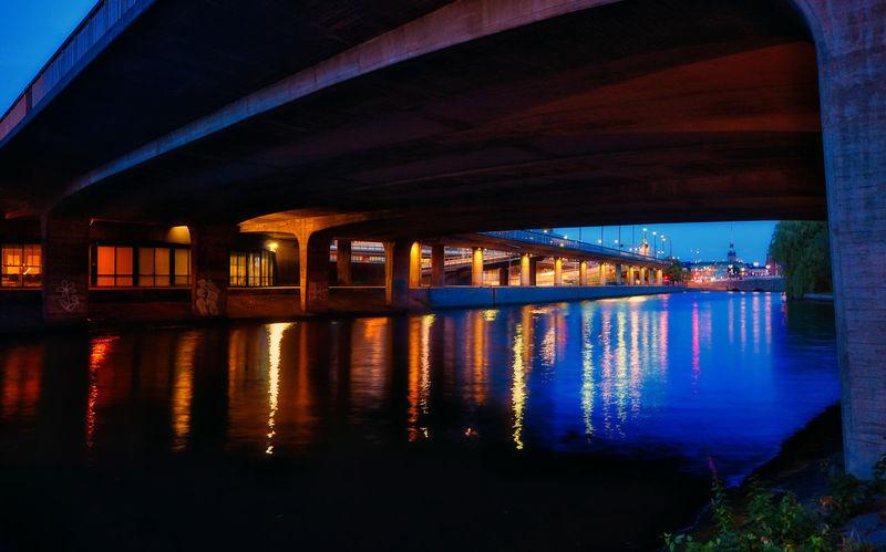 Under the bridge... https://www.instagram.com/johnmaren/ https://www.photobymaren.com https://plus.google.com/u/0/+JohanMarengard https://www.flickr.com/photos/115763201@N02/ Water Built Structure Bridge Reflection Bridge - Man Made Structure Illuminated Night No People River Waterfront Dusk Underneath Nightphotography Nightlights Waterreflections  Reflection