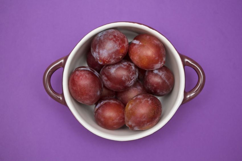 plums in a purple bowl on purple background Bowl Close-up Directly Above Food Food And Drink Freshness Fruit Healthy Eating No People Plum Purple Purple Background Studio Shot