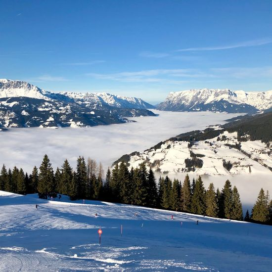 Sunny highs, foggy lows Snow Cold Temperature Winter Mountain Nature Scenics Beauty In Nature Tranquil Scene Tranquility Blue Snowcapped Mountain Day White Color Outdoors Sky Mountain Range Frozen Winter Sport