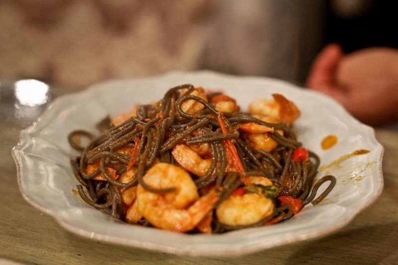 Close-up of prawns noodles served in plate