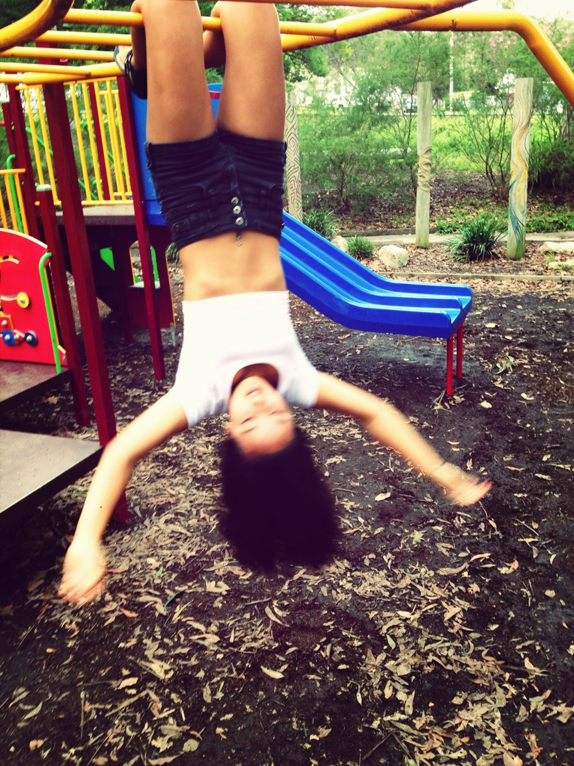 childhood, leisure activity, lifestyles, elementary age, park - man made space, person, playground, sitting, full length, casual clothing, girls, relaxation, chair, fun, boys, swing, enjoyment, playful