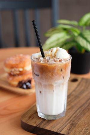 Food And Drink Drink Food Refreshment Drinking Straw Straw Table Glass Drinking Glass Indoors  Household Equipment Focus On Foreground Close-up Wood - Material Freshness Healthy Eating No People Milk Cold Drink Still Life Herb Latte Iced Latte