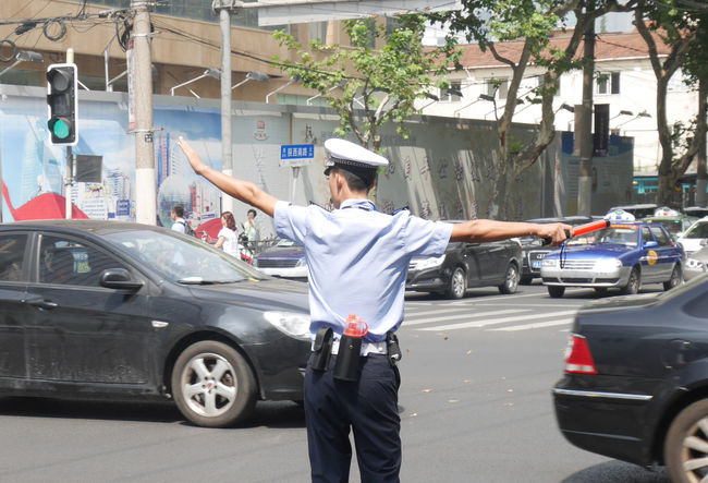 Mobility In Mega Cities Road Shanghai Streets Traffic Car City Gesturing Land Vehicle Mode Of Transport Outdoors People Road Sign Standing Street Photography Streetphotography Transportation
