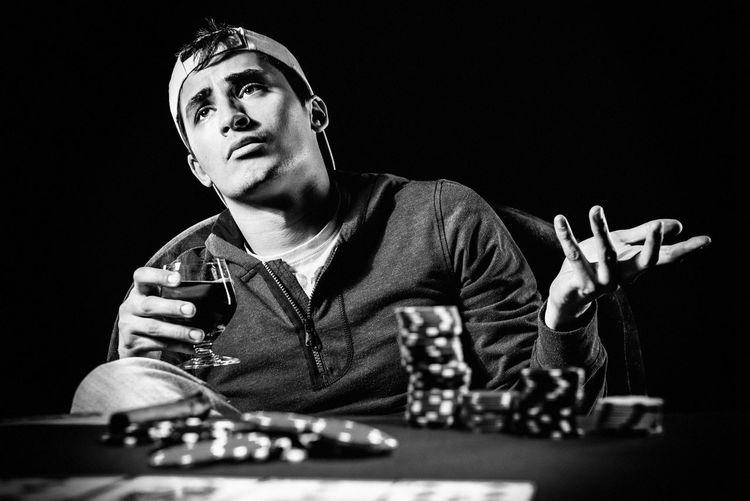 Poker player. Gambling concept Blackjack Casino Gambling Jackpot Man Poker Addiction Alcohol Black And White Casino Night Entertainment Gambler Gambling Chip Game Leisure Games Male Player Playing Card Games Poker - Card Game Poker Chips Poker Game Studio Shot Young Adult