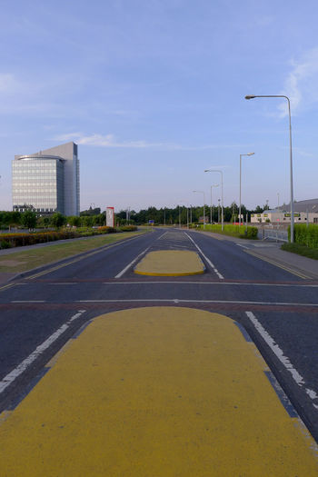 Traffic islands, Blanchardstown Shopping Centre, Dublin, Ireland Architecture Asphalt Blanchardstown Building Exterior Built Structure City Day Dividing Line Dublin Empty Ireland No People Outdoors Road Road Sky The Way Forward Traffic Islands Transportation Yellow