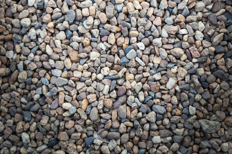 Stone pebbles texture background for interior exterior decoration and industrial construction concept design. Dark Modern Natural Nature Rock Textured  Wall Abstract Abundance Background Backgrounds Beach Black Board Close-up Closeup Day Directly Above Full Frame Gray Grey High Angle View Land Large Group Of Objects Marble Nature No People Old Outdoors Pattern Pebble Rock Slate Solid Still Life Stone Stone - Object Surface Table Texture Textured  Textured Effect Vintage Wallpaper