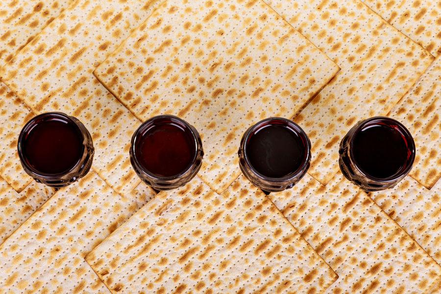 Matzot and red wine four glasses of symbols of Passover Passover Torah Hebrew Jewish Holiday Judaism Kiddush Kosher Kosher Food Matzah Passover Jewish Passover Jewish Pesach Pesachah Pesachah Unleavened Unleavened Bread Wine