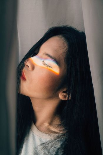 Prism light falling on woman eye