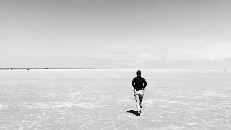 Rear View Of Woman Walking On Slat Flat