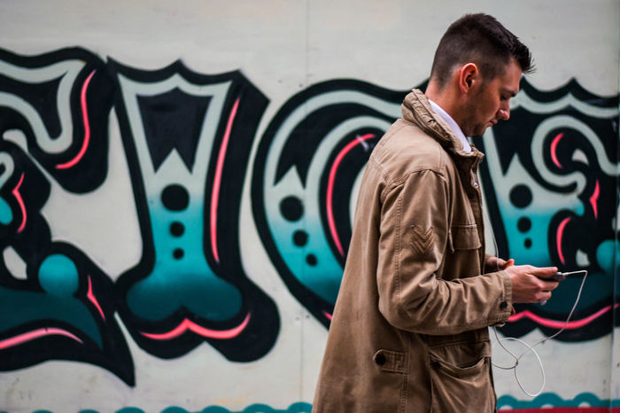 People EyeEm Selects Nikon Cities Communication Connection Documentary Graffiti Lifestyles Nikonphotography One Person Real People Streetlife Streetphotography Town Walking Wall - Building Feature #urbanana: The Urban Playground