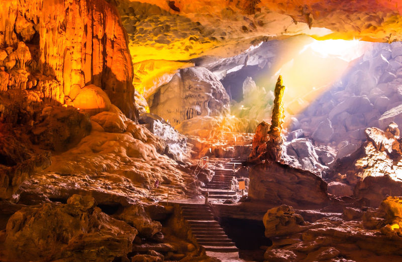 Stalagmite Gold Halong Bay  Natural Nature Stalactite  Sung Sot Cave Sunlight Tourist Travel Trip UNESCO World Heritage Site Vietnam Attraction Beam Cave Chamber Destination Grotto Halong Sung Sot Surprise Cave Tourism Unesco Vacation