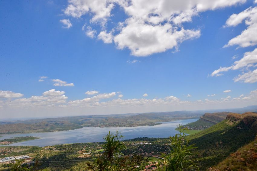 Hartbeespoort dam Scenics Sky Beauty In Nature Nature Tranquility Tranquil Scene Cloud - Sky Mountain Sea Outdoors Day Water No People Landscape Mountain Range Blue Beach Horizon Over Water Grass Hartbeespoort Dam Travel Destinations South Africa Hartbeespoort Dam Wall Hartebeespoort Harties