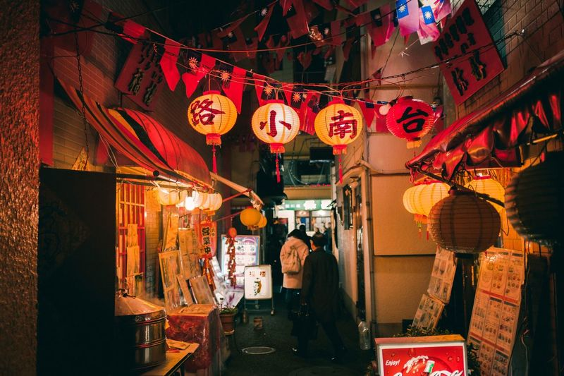 Night Illuminated Women Lighting Equipment Adult Real People Architecture Building Exterior Lantern Built Structure Lifestyles City