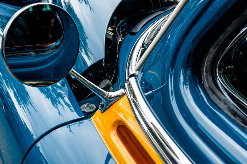 Close Reflection Backgrounds Blue Close-up Cropped Day Detail Full Frame Headlight Land Vehicle Mode Of Transport No People Outdoors Parked Parking Part Of Stationary Tire Transportation Vehicle Hood Vehicle Part Vintage Car Yellow