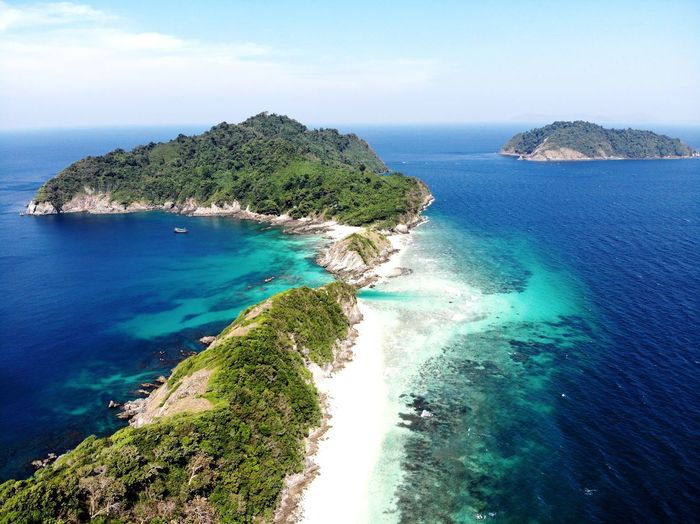 Top view of the island Summer Beach Thailand Dronephotography Island Background Isolated Sea Water Beauty In Nature Scenics - Nature Sky Land Tranquility Nature Tranquil Scene Beach No People Idyllic Day Plant Blue Horizon Over Water Horizon Cloud - Sky Rock Outdoors