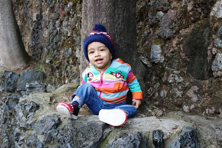 Child Wool Multi Colored Boys Cap Knit Hat Outdoors Childhood Headwear Day Nature Check This Out Taking Photos Hello World Photography Day Dreaming Beauty In Nature Nature Growth Tree Tree Trunk Baby Babyboy Baby Photography Baby Boy