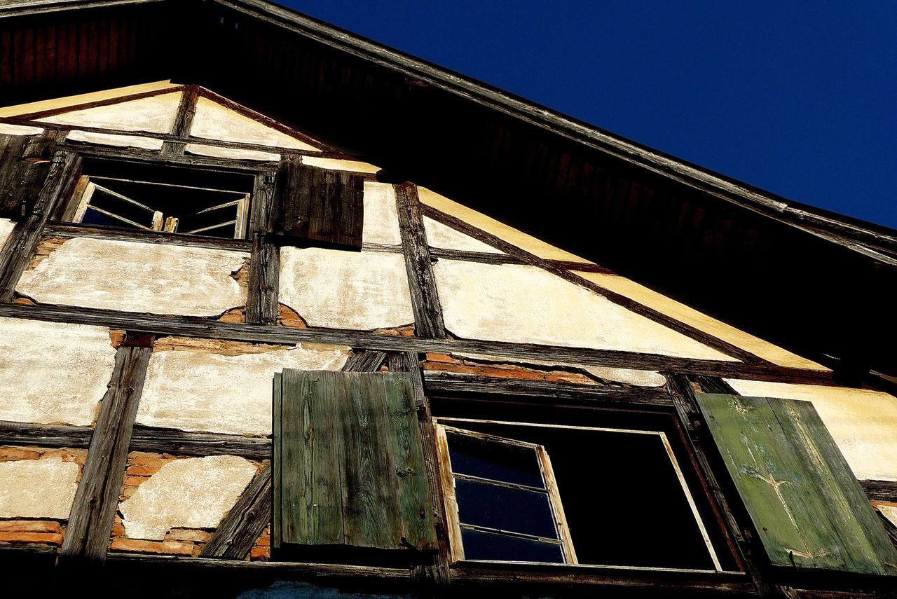 low angle view, built structure, architecture, building exterior, no people, outdoors, day, abandoned, window, clear sky, sky