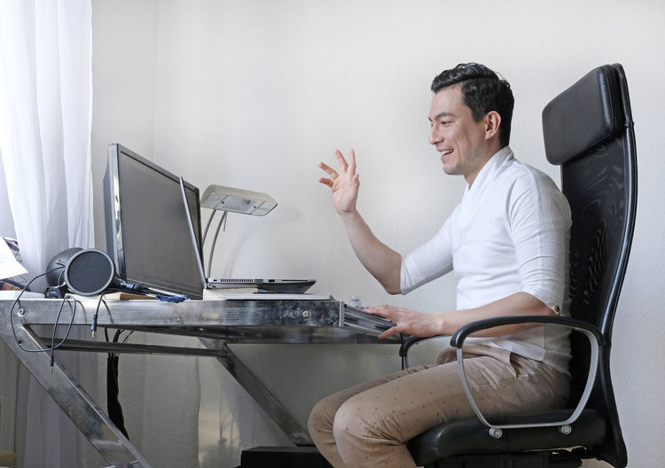 Man using computer on table