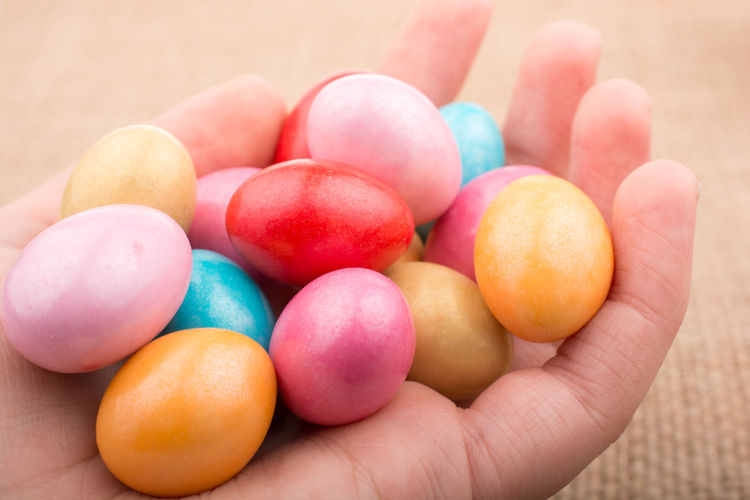 Close-up Day Dessert Easter Easter Egg Egg Food Food And Drink Freshness Healthy Eating Holding Human Body Part Human Finger Human Hand Indoors  Indulgence Lifestyles Multi Colored One Person Ready-to-eat Real People Sweet Food Temptation Unrecognizable Person Variation