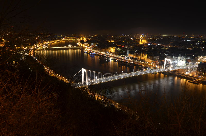 High angle view of chain bridge over danube river against sky in city at night