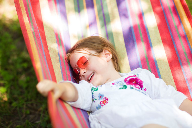 Portrait of cute girl lying outdoors