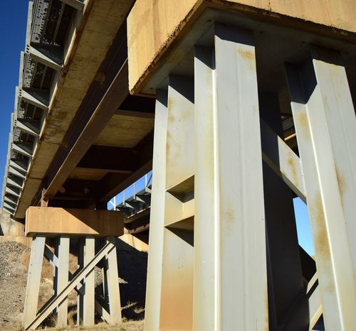 View through girders Railling Metal Girders Concrete Railroad Bridge Two Tracks View From Below Tall Structure Outdoors Shadows West Of Shawnee Wyoming Clear Sky Built Structure