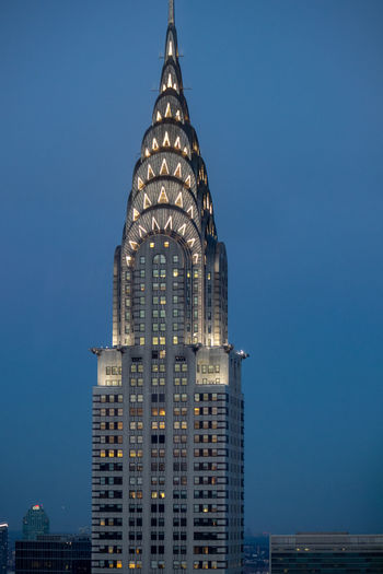Chrysler Building NYC Architecture Blue Building Building Exterior Built Structure City Clear Sky Financial District  Illuminated Luxury Modern Nature No People Office Office Building Exterior Sky Skyscraper Spire  Tall - High Tourism Tower Travel Travel Destinations