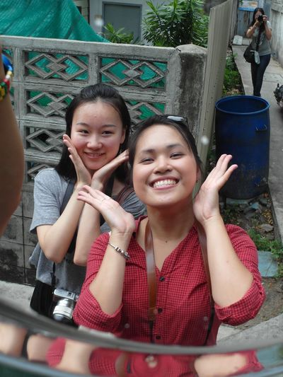 Happy faces by a reflection of a mirror, 2 UN interns in Bangkok. My friend Miki is shooting us from the top right corner. The Protraitist - 2015 Eyeem Awards The Photojournalist - 2015 EyeEm Awards Open Edit The Traveler - 2015 EyeEm Awards Check This Out The Street Photographer - 2015 EyeEm Awards EEA3 Walking Around That's Me Taking Photos
