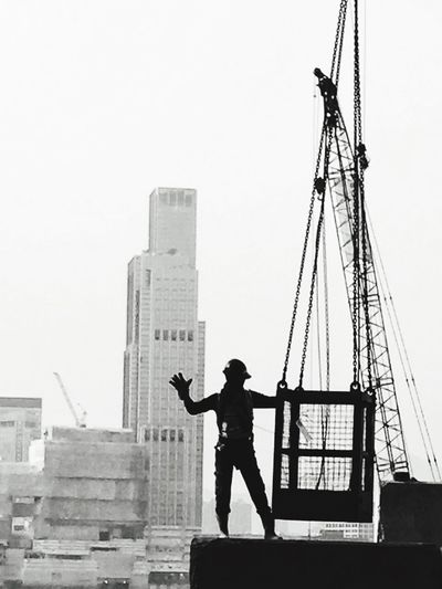 The Street Photographer - 2017 EyeEm Awards Architecture Built Structure Real People One Person Standing Crane Black & White Black And White Blackandwhite Worker At Work Construction Worker Construction Construction Site Worker Iphotography Iphonephotography Tsuistyle Photography Hardhat  Standing Silhouette Occupation