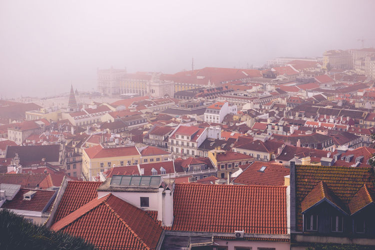 View of Lisbon on a foggy day. Architecture Built Structure Travel Destinations Lisbon Portugal Europe Building Exterior Roof City Building Residential District House High Angle View Crowded Cityscape Nature Town Fog Day Outdoors Sky TOWNSCAPE Roof Tile Settlement