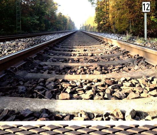 On track Railroad Track Transportation Rail Transportation Day Outdoors The Way Forward No People Surface Level Low Angle View Straight Forward New Horizons Pedestrian Crossing EyeEm Best Shots