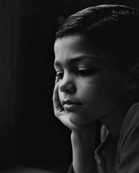 Thoughtful Boy In Room At Home