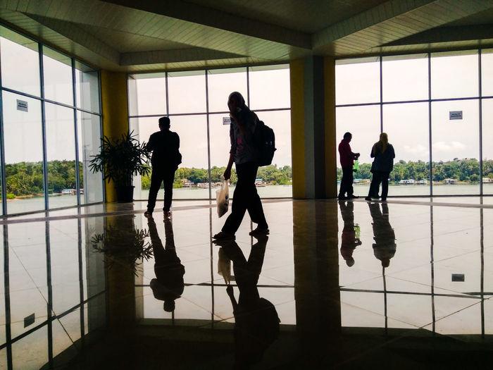 Silhouette people reflecting on floor