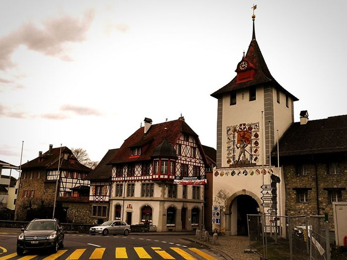 Street Photography Car Driving Historic Buildings  Sempach Switzerland Historisch Sempach Stadttor Architecture Travel Destinations History Building Exterior Outdoors Built Structure Clock Tower Day Sky City Clock No People
