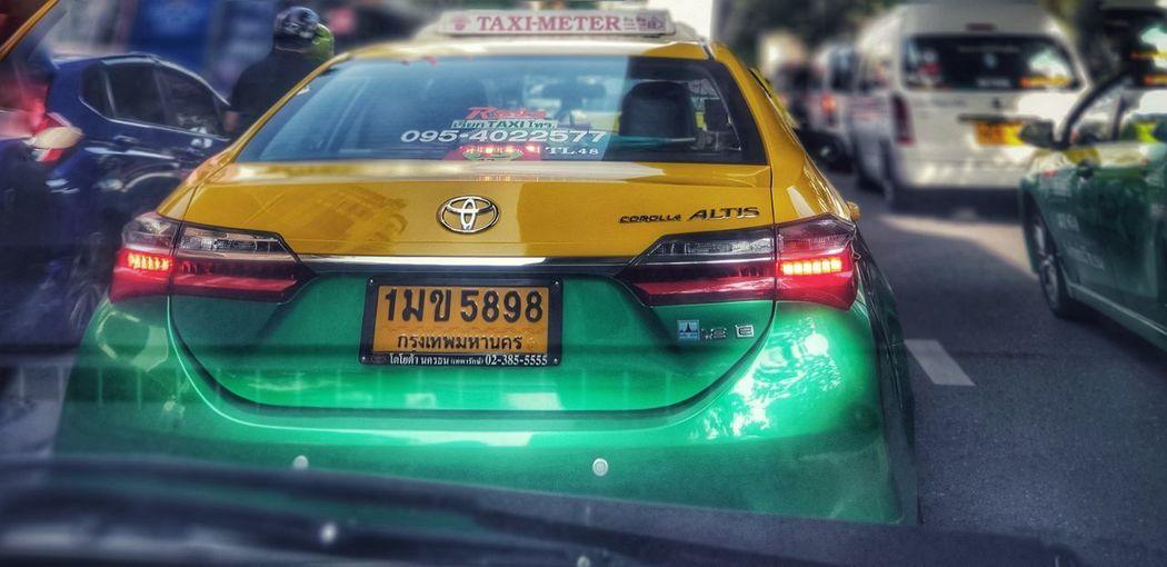 Bangkok Thailand. Yellow Taxi City Car Taxi Traffic Rush Hour Close-up