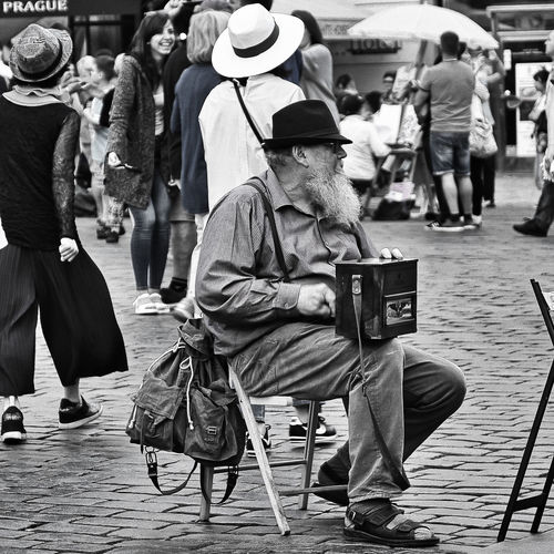 Street Artist Adult Casual Clothing City Clothing Crowd Day Focus On Foreground Full Length Group Of People Holding Incidental People Lifestyles Market Men People Real People Rear View Sitting Street Street Photography Walking Cane EyeEmNewHere