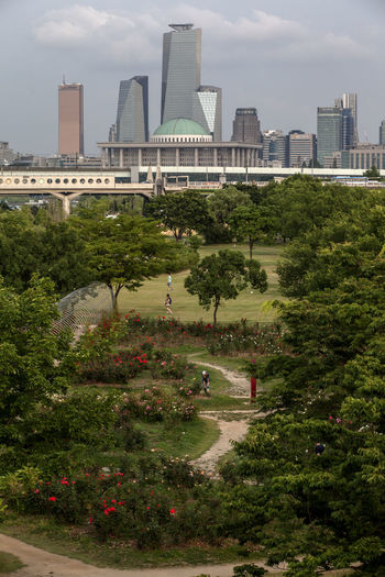 Architecture Built Structure City City Life Cityscape Cloud Cloud - Sky Cloudy Dangsan Day Grass Green Color Growth Lawn Modern Nature Outdoors Park Parliament Building Plant Sky Tourism Travel Destinations Tree Yeouido