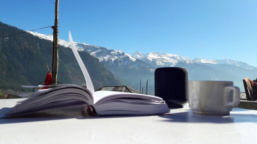 Reading Books Coffee Cup Read Reading Coffee Books Novel Author Mountain Mountain View Mountains And Sky Wallpaper Bike Trip Mountains Travel Travel Destinations Sunlight Nature Sky Day Mountain Clear Sky Architecture Built Structure Blue Snow Sunny Cold Temperature Outdoors Winter