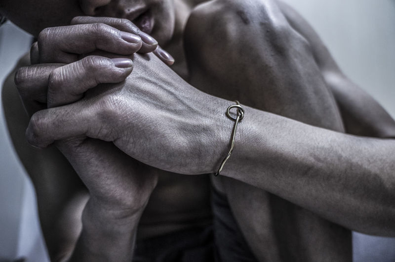 Cropped Image Of Naked Man With Hands Clasped