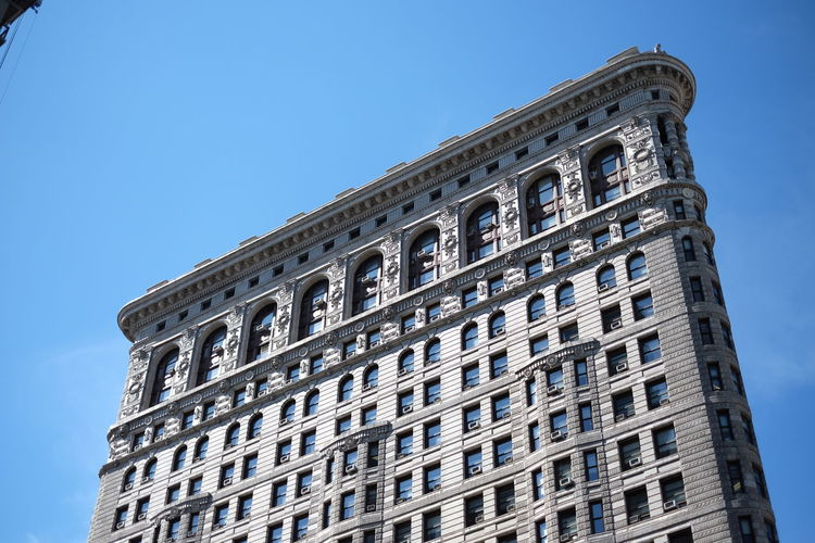Low angle view of historic flatiron building against sky