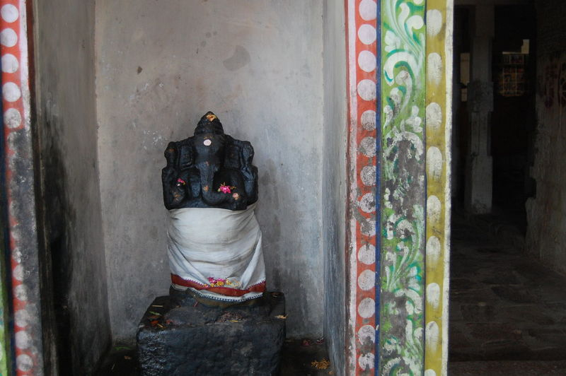Ganesha idol covered in white cloth at temple