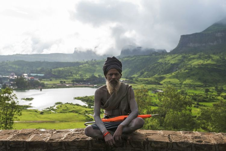 Picturing Individuality A saint resting while hicking up to bhramagiri peak to see the holy rive Godavari in Trimbakwshwar, India. Nashik Trimbakeshwar Saint Sadhu Umbrella Mountains Orange Showcase: December Enjoy The New Normal TCPM