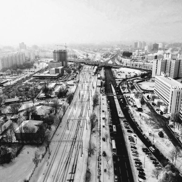 High Angle View Transportation Nature Day Mode Of Transportation Cold Temperature Track Railroad Track Winter No People Snow Building Exterior Architecture Rail Transportation Built Structure Cityscape Outdoors Public Transportation Sky