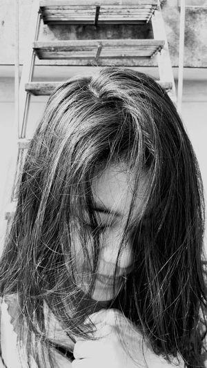Close-up of teenage girl with eyes closed against steps