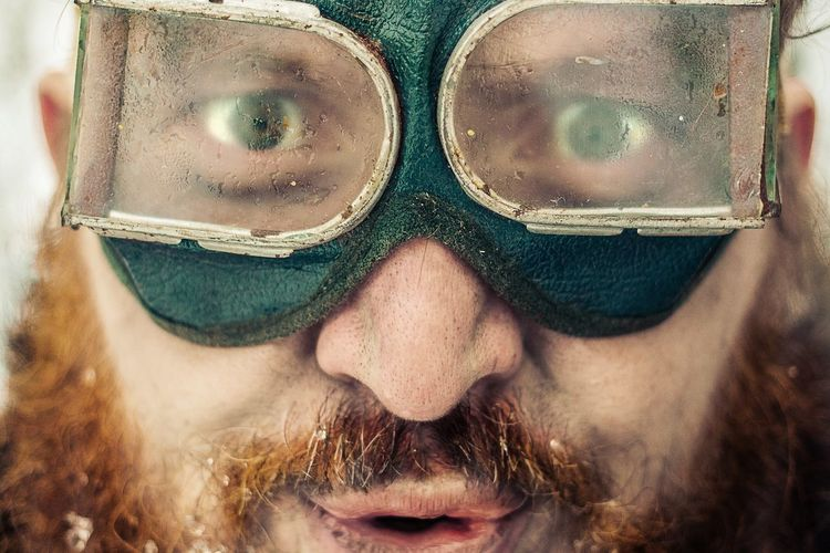 Close-up portrait of man wearing goggles during winter