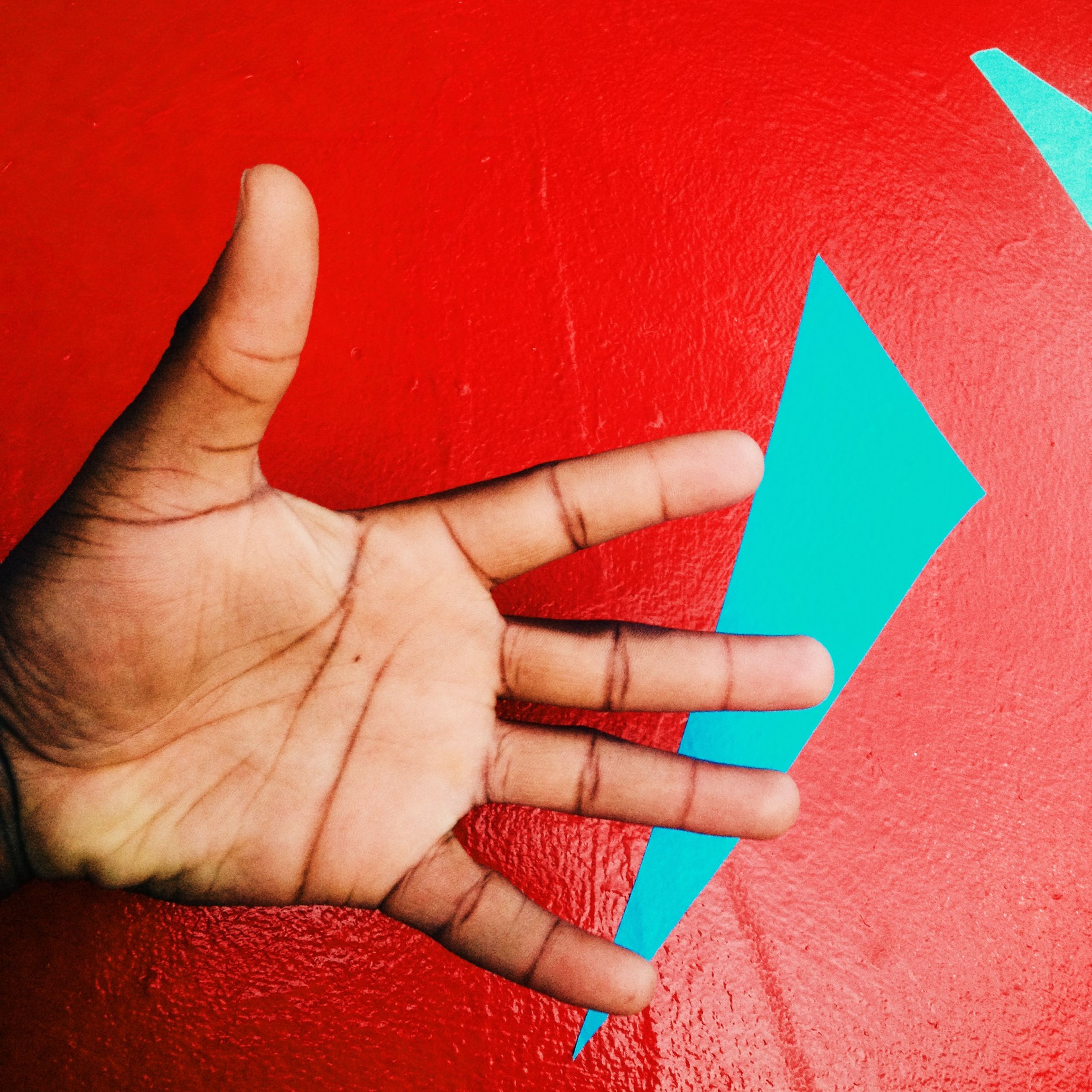 red, person, part of, wall - building feature, cropped, lifestyles, personal perspective, close-up, human finger, high angle view, indoors, unrecognizable person, holding, leisure activity, low section