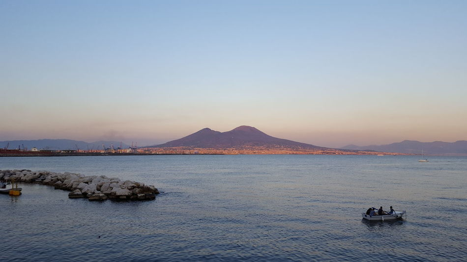 Napoli Vesuvio Vesuvio Da Napoli Volcano Sunset Clear Sky Outdoors Landscape Tranquility Beauty In Nature No People Scenics Blue Water Gulf Of Naples Italia Italy Your Ticket To Europe The Week On EyeEm Fantastic View Mix Yourself A Good Time Lost In The Landscape The Great Outdoors - 2018 EyeEm Awards The Traveler - 2018 EyeEm Awards A New Beginning