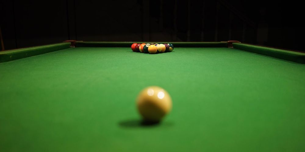 Close-up of pool balls on table against black background