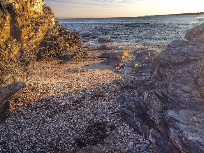 Rock Formation Rock Cliffs On Ocean Water. Jamestown, RI, USA Around Me Photo. Jamestown RI